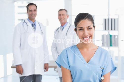 Nurse and doctors smiling at camera