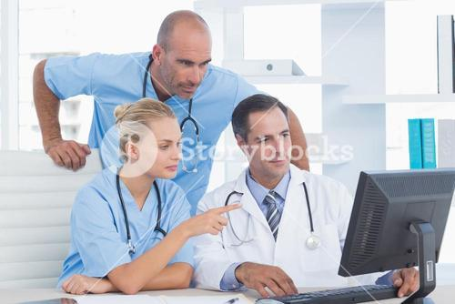 Doctors and surgeon working with computer