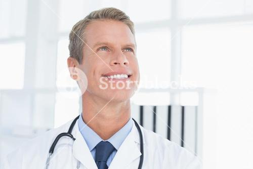 Smiling doctor looking at top