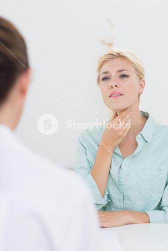 Patient with sore throat visiting doctor