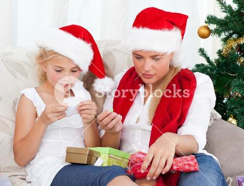 Wonderful woman on christmas day with her daughter