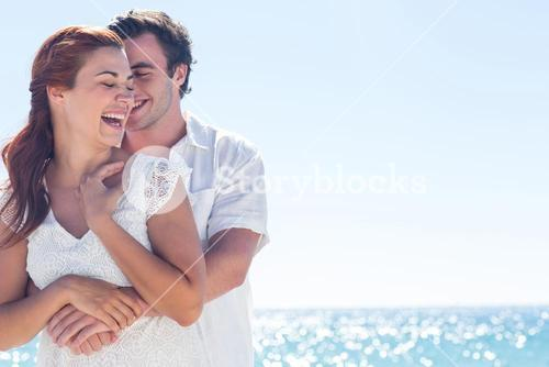 Happy couple hugging and laughing together