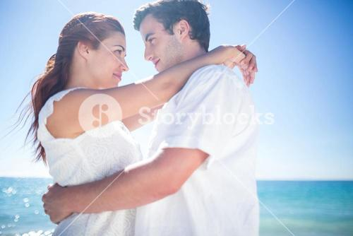 Happy couple hugging and smiling at each other