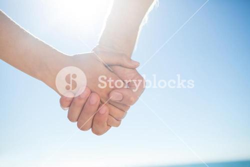 Couple walking hand in hand