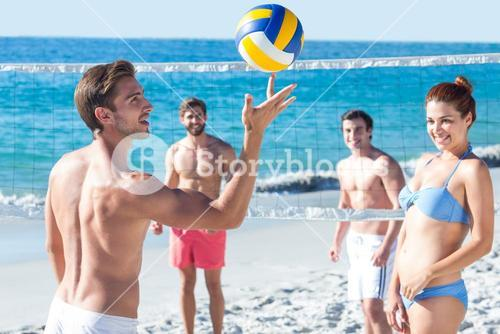 Friends playing volleyball