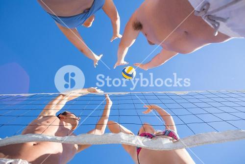 Group of friends playing volleyball