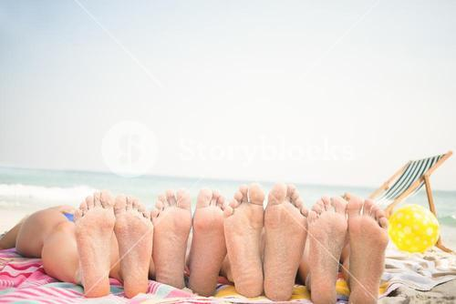 group of friends lying on towels