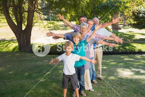 Happy family with arms outstretched in the park