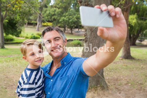 Happy father taking a selfie with his son
