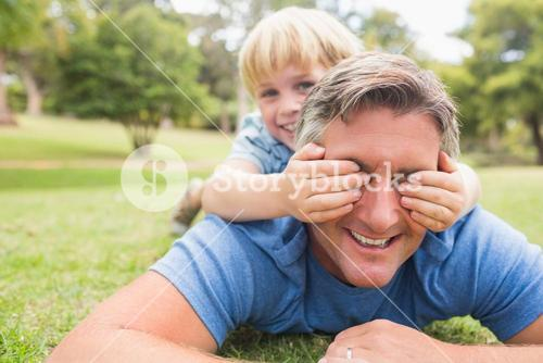 Happy father and his son smiling at camera