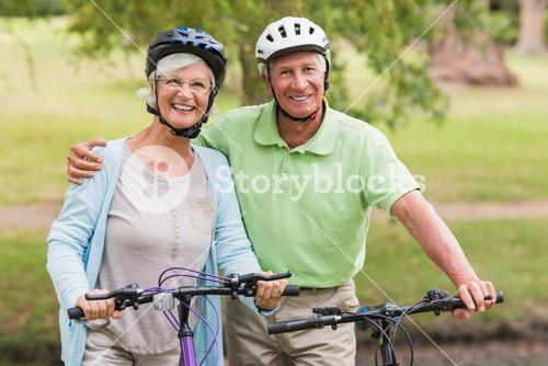 Happy senior couple on their bike