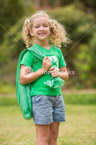 Eco friendly little girl smiling to camera