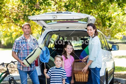 Happy family getting ready for road trip