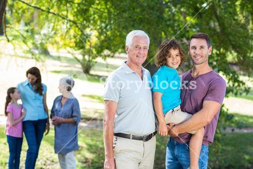 Extended family smiling in the park