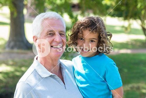 grandfather and grandson having fun in a park