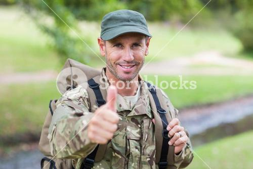 Soldier looking at camera thumbs up