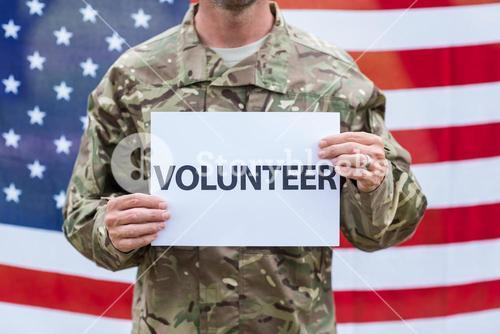 American soldier holding recruitment sign