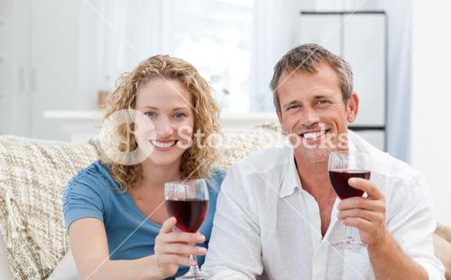 Couple drinking some red wine in the living room