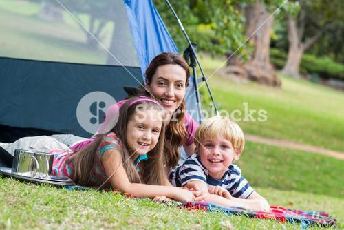mother and children having fun in the park