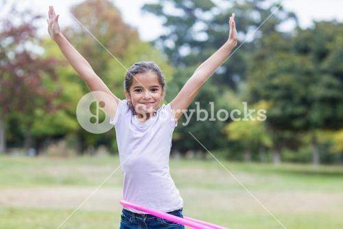 happy girl playing with hula hoops