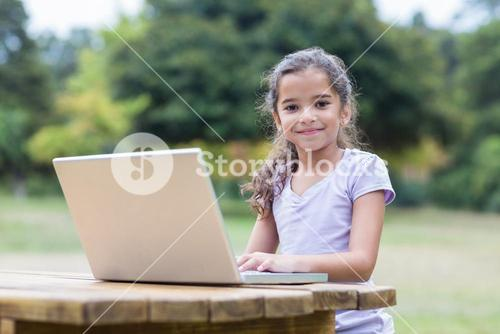 Little girl using her laptop