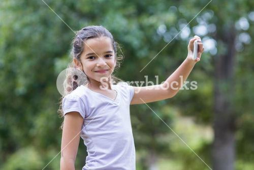 Little girl using her phone