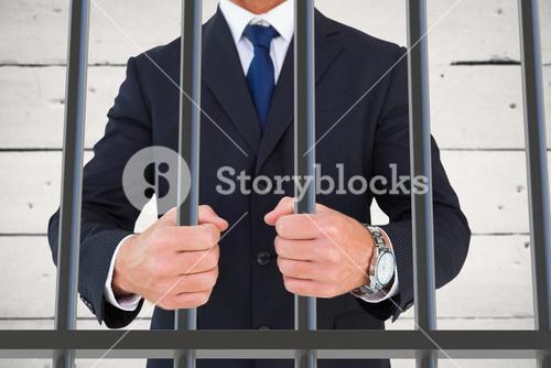 Composite image of portrait of a businessman clenching fists