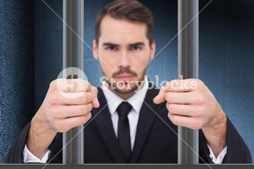 Composite image of exasperated businessman with clenched fists