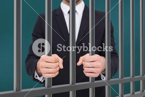 Composite image of elegant businessman in suit clenching his fists