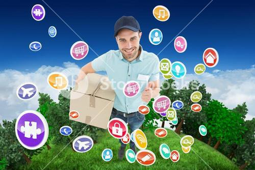 Composite image of delivery man with cardboard box gesturing thumbs up