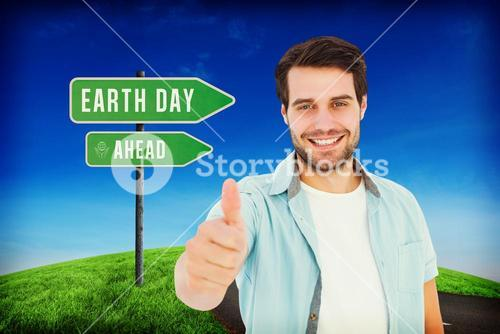 Composite image of happy casual man showing thumbs up