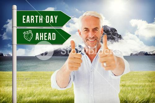 Composite image of smiling man showing thumbs up to camera