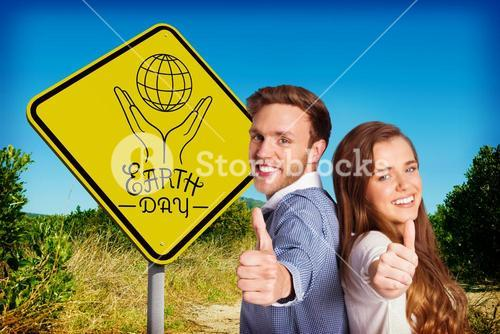 Composite image of happy young couple gesturing thumbs up