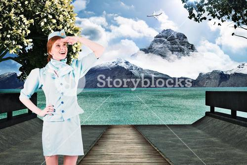 Composite image of pretty air hostess looking up