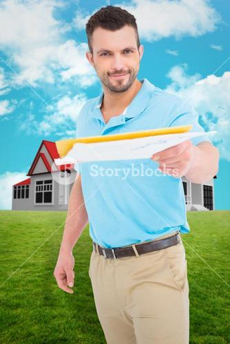 Composite image of postman with letter