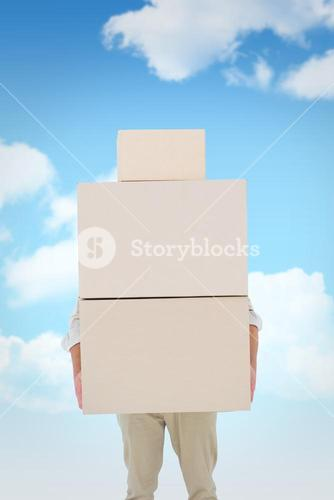 Composite image of courier man carrying cardboard boxes