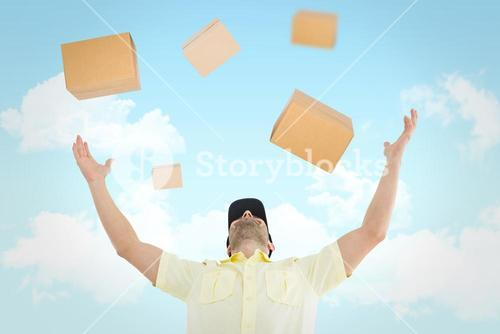 Composite image of delivery man with arms raised