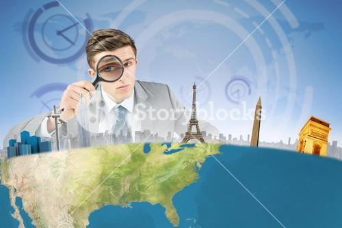 Composite image of businessman with magnifying glass