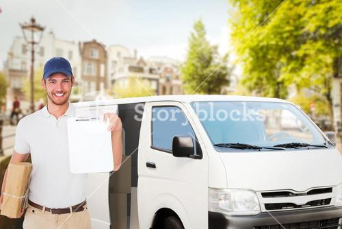 Composite image of happy delivery man holding cardboard box and clipboard