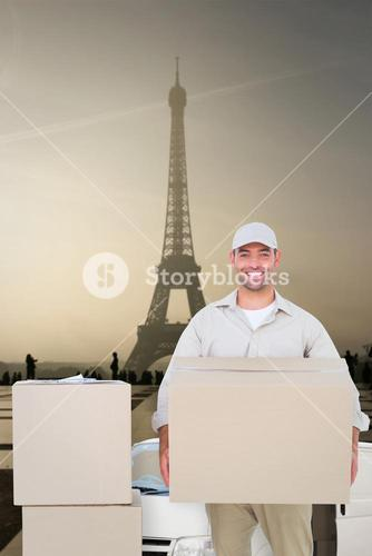 Composite image of courier man carrying cardboard box