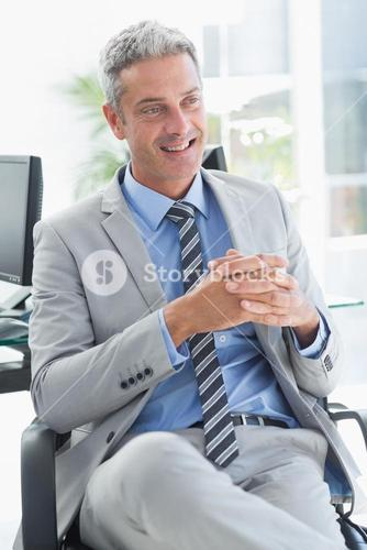 Thoughtful businessman sitting on a chair