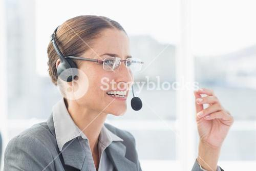 Businesswoman with headset in call centre