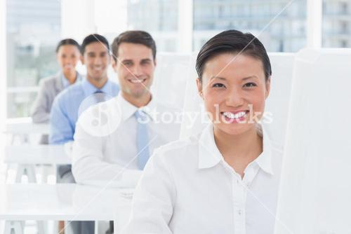Smiling work team using computer