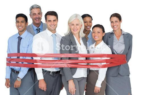Smiling business people surrounding by red strip