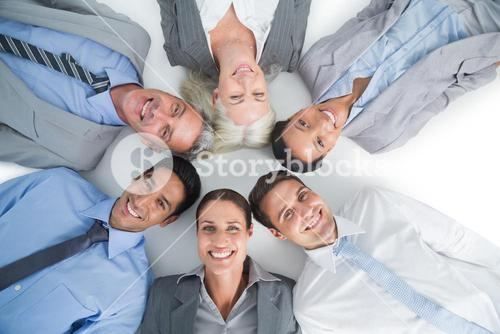Young business people lying in circle