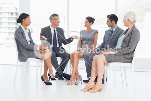 Business people in board room meeting