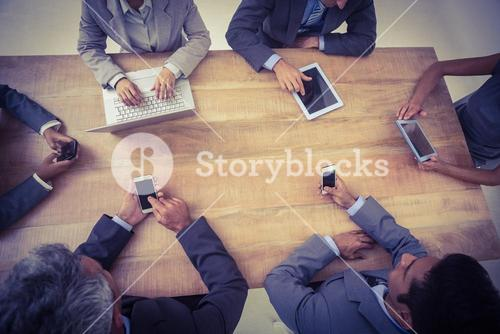 Business people in meeting with new technologies