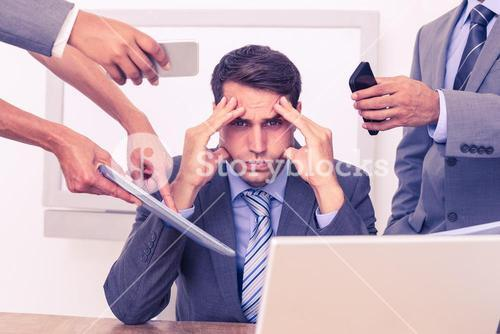 Worried businessman with head in hands