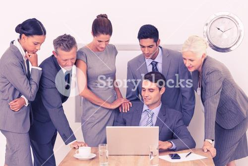 Business people using laptop