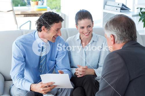 Couple in meeting with a financial adviser